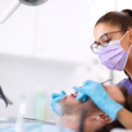 young female dentist working with patient